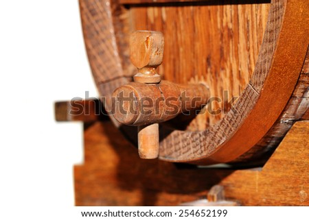 Close up of a miniature beer keg and tap isolated on white - stock photo