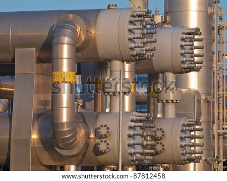 close up of a modern natural gas processing plant during sunset - stock photo