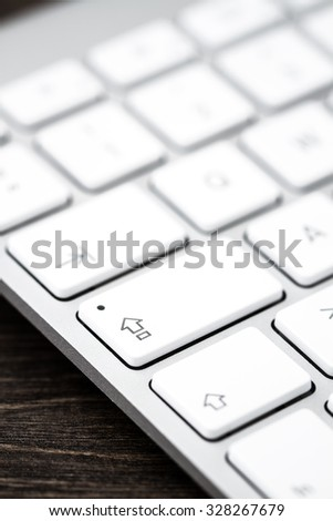 Close up of a modern white, gray computer keyboard. Focus on caps lock. - stock photo