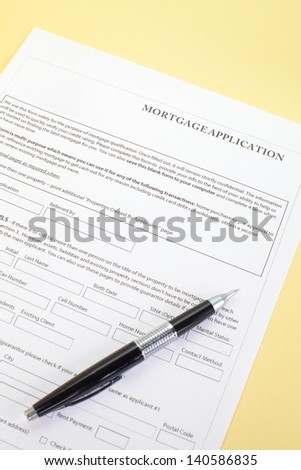 Close up of a mortgage application and a pen - stock photo