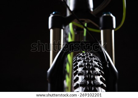 close-up of a mountain bike spring fork, studio shot. - stock photo