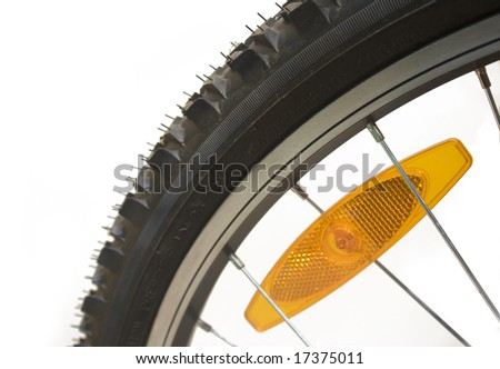 Close-up of a mountain bike tyre with reflector - stock photo