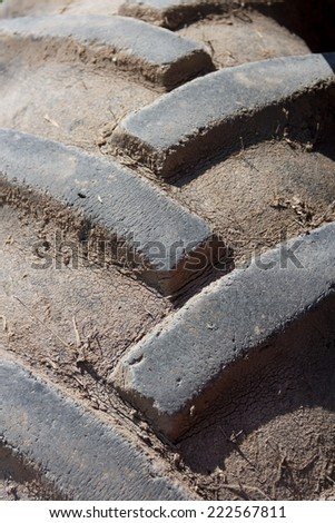 Close up of a muddy tractor tire - stock photo