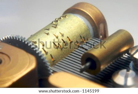 Close up of a musical box comb and barrel. - stock photo