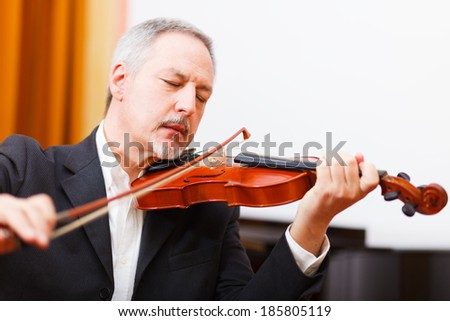 Close-up of a musician playing his violin - stock photo