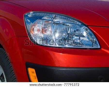 Close Up of a New Car Headlight - stock photo