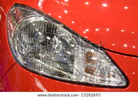 Close-up of a new modern car head lamp - stock photo