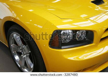 Close-up of a new modern muscle car - stock photo