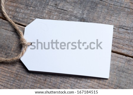Close up of a note and a clothes peg on grunge wooden background with clipping path  - stock photo
