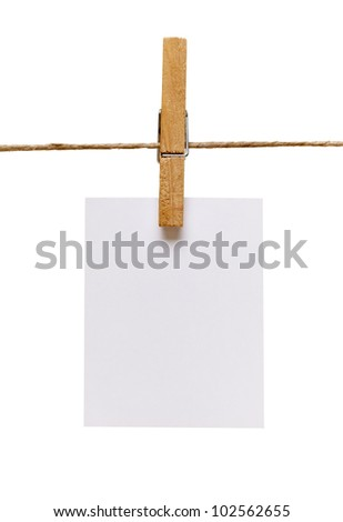 close up of  a note and a clothes peg on white background with clipping path - stock photo