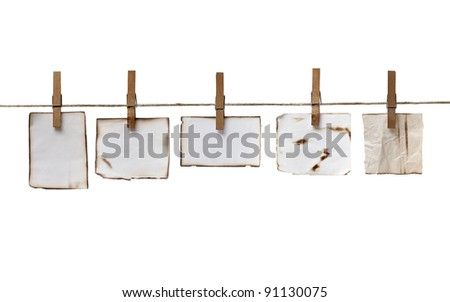 close up of  a notes and a clothes pegs on white background - stock photo