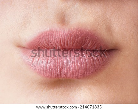 close-up of a pair of female lips - stock photo