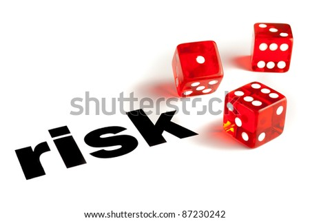 Close up of a pair of transparent dice on  word risk - stock photo