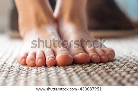 Close-up of a pair of young boys feet - stock photo