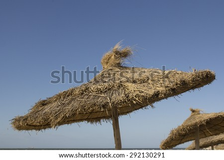 close up of a parasol at on a deserted beach - stock photo