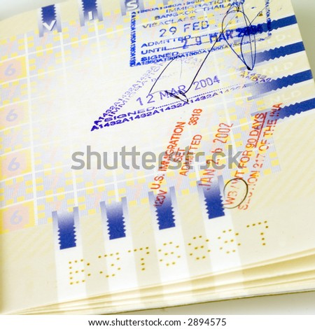Close up of a passport with Visa stamps - stock photo