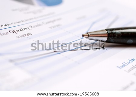 Close-up of a pen on a document.