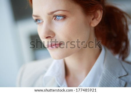 Close-up of a pensive female face - stock photo