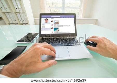 Close-up Of A Person Chatting On Social Website In Office. Photographer owns copyright for images on screen - stock photo