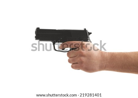 Close-up of a person's hand holding gun over white background - stock photo