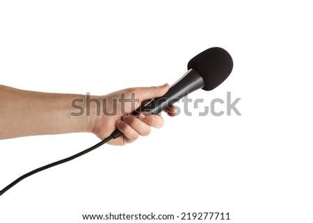 Close-up of a person's hand holding microphone on white background - stock photo