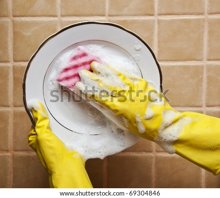close up of a person washing a plate - stock photo