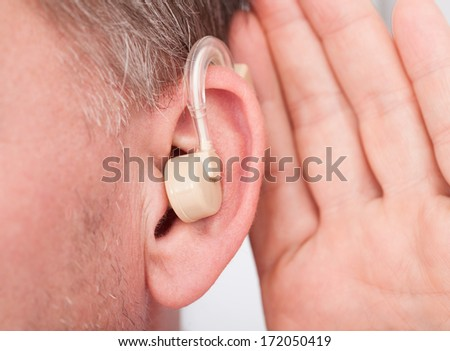 Close-up Of A Person Wearing Hearing Aid - stock photo