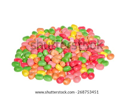 Close up of a pile of colorful chocolate coated candy, isolated on the white background - stock photo