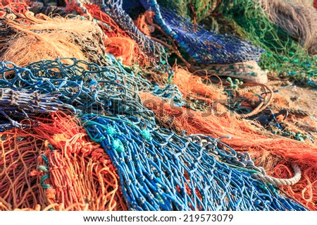 Close up of a pile of colorful fishing nets. Very shallow depth of field. - stock photo