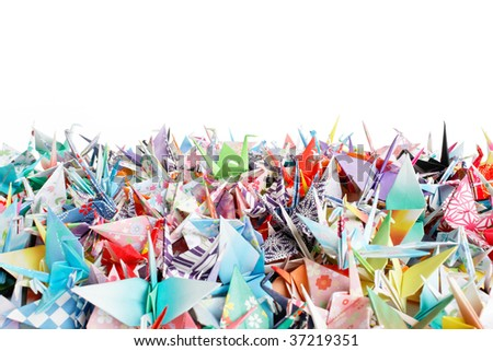 Close up of a pile of origami birds on a white background - stock photo