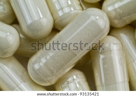 Close up of a pile of white capsules pills.