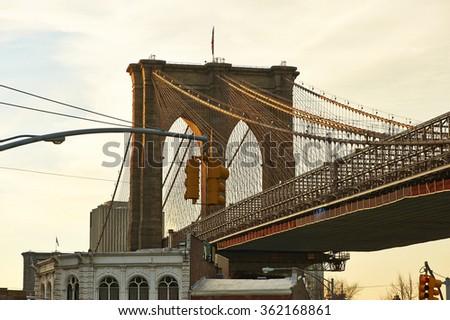 Close up of a pillar of the Brooklyn bridge at sunset, New York City, USA - stock photo