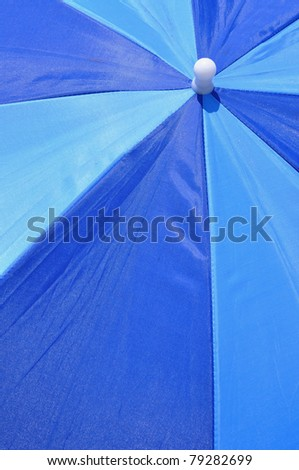 Close up of a pretty beach umbrella useful as a background pattern - stock photo