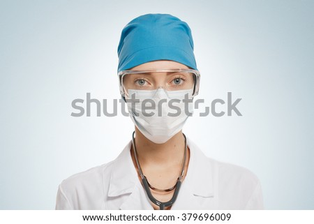 Close up of a pretty female surgeon. Looking confident and professional.