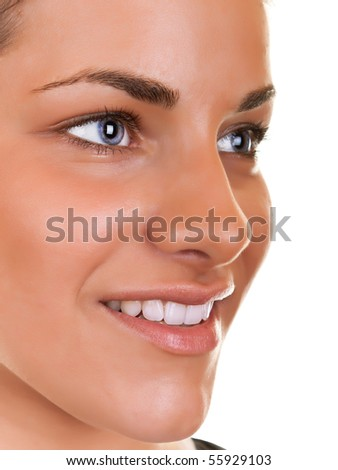 close-up of a pretty girl smiling on white background