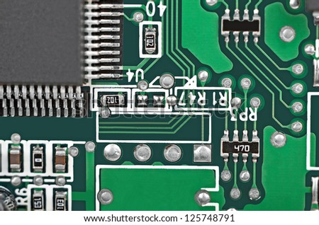 Close up of a printed green computer circuit board