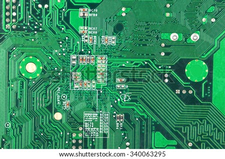 Close up of a printed green computer circuit board - stock photo