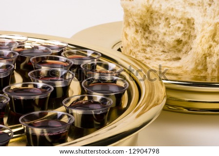 Close-up of a Protestant style communion tray with wine glasses and a plate with bread. - stock photo