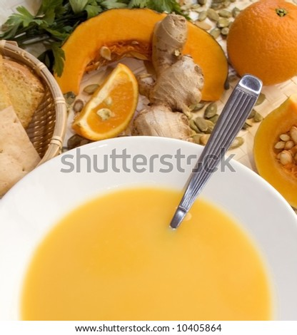 Close up of a pumpkin, orange and ginger soup. - stock photo