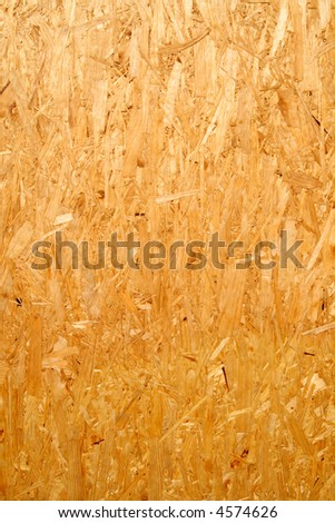 Close up of a recycled compressed wood chippings board.