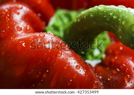 Close-up of a red bell pepper with water drops, organic, fresh, healthy food. - stock photo