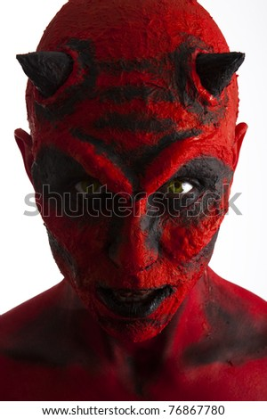 Close up of a red devil woman. White background.