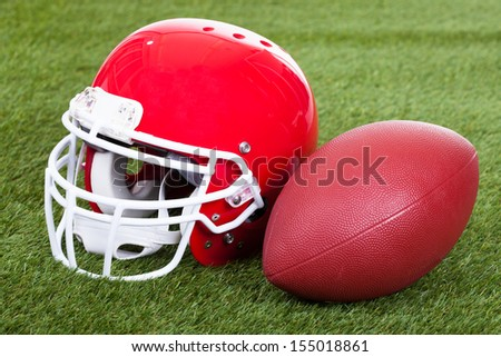 Close-up Of A Red Football Helmet On Field - stock photo