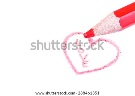 Close up of a red pencil and a drawn heart with the word love inside - stock photo