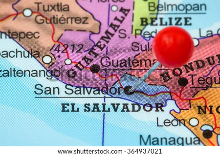 Close-up of a red pushpin in a map of San Salvador, El Salvador.