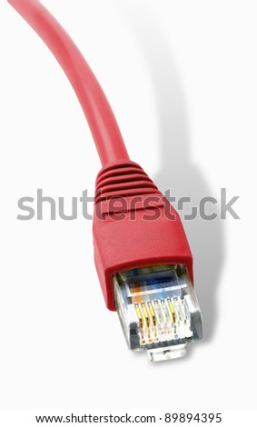 Close-up of a red RJ45 network plug with shadow. - stock photo