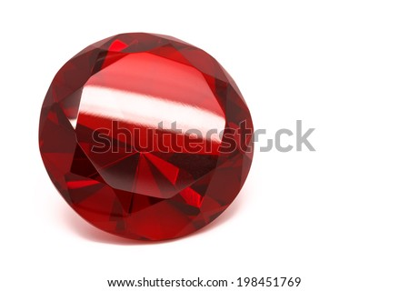 Close-up of a red ruby crystal isolated on a white background.