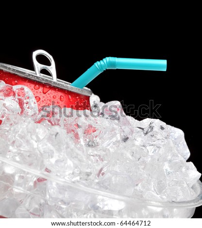 Close up of a red soda can in a bucket of ice with a blue straw. Black background with shallow depth of field focus is on can and straw. - stock photo