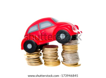 close-up of a red toy car on a pile of euro coins on a white background.  - stock photo