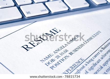 close up of a resumé or cv document with blue duotone effect - stock photo